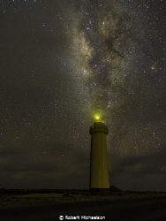The Milky Way at the lighthouse on Bonaire by Robert Michaelson